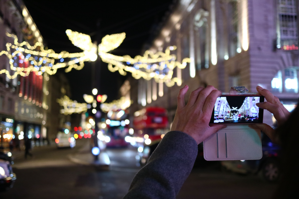 someone taking picture of decorations in london