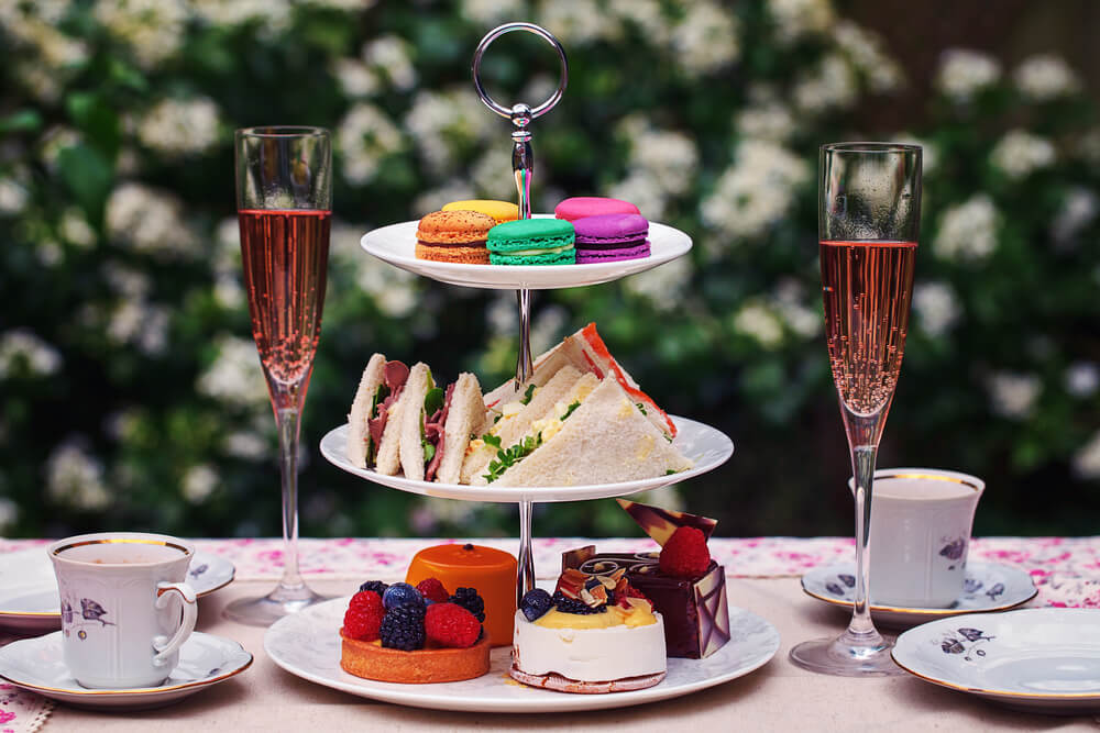 Afternoon tea with chilled glass of champagne